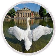 Swan Spreads Wings In Front Of State Theatre Stuttgart Germany Round Beach Towel by Matthias Hauser