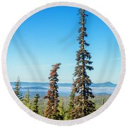 Tall Pine Trees And Hilly Background Round Beach Towel