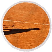Tennis Player Shadow On A Clay Tennis Court Round Beach Towel