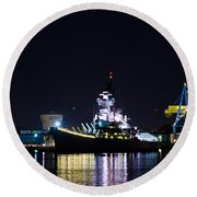 The Battleship New Jersey At Night Round Beach Towel