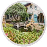 The Beautiful Courtyard Of The Pacific Asia Museum In Pasadena. Round Beach Towel