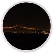 The Cityscape At Night Round Beach Towel