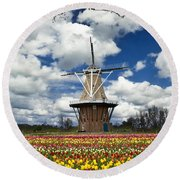 The Dezwaan Dutch Windmill Among The Tulips On Windmill Island In Holland Michigan Round Beach Towel