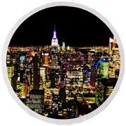 The Glow Of The New York City Skyline Round Beach Towel