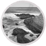 The Jagged Rocks And Cliffs Of Montana De Oro State Park In California In Black And White Round Beach Towel