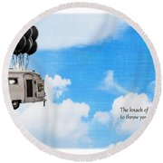 The Knack Of Flying Round Beach Towel by Edward Fielding