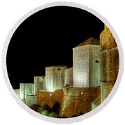 The Landside Walls Of Dubrovnik At Night No2 Round Beach Towel