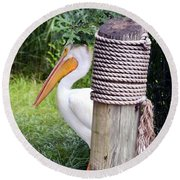 The Lone Pelican Round Beach Towel