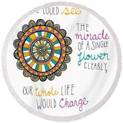 The Miracle Of A Flower Round Beach Towel