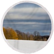 The Optimist's Edge Of Winter Round Beach Towel