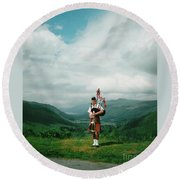 The Piper At The Great Glen Round Beach Towel