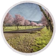 The Promise That Spring Makes Round Beach Towel