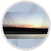 The Red River's Setting Sun Round Beach Towel