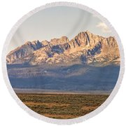 The Sawtooths' Round Beach Towel by Robert Bales