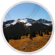 The Sugar Coated Mountains Round Beach Towel