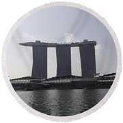 The Three Towers Of The Marina Bay Sands In Singapore Round Beach Towel