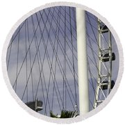The Top Section Of The Marina Bay Sands As Seen Through The Spokes Of The Singapore Flyer Round Beach Towel