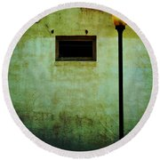 The Wall And The Lamppost Round Beach Towel