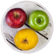 Thee Apples On A Table Round Beach Towel