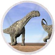 Three Argentinosaurus Dinosaurs Round Beach Towel by Elena Duvernay
