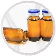 Three Glass Bottles With Medicine Round Beach Towel