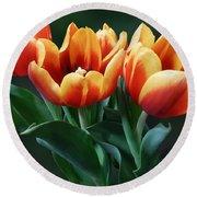 Three Orange And Red Tulips Round Beach Towel