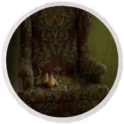 Three Pears Sitting In A Wing Chair Round Beach Towel by Priska Wettstein