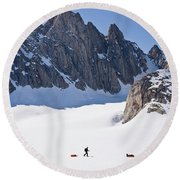 Three People Ski-tour On Karale Glacier Round Beach Towel
