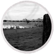 Through The Fence Round Beach Towel