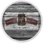 Toppling Goliath Round Beach Towel