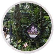 Tourist Doing Photography And Viewing Plants In A Garden Round Beach Towel