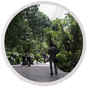 Tourists Inside A Downward Sloping Section In The Orchid Garden Round Beach Towel