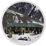 Tourists Surrounded By Snow And Ice Outside One Of The Few Buildings Round Beach Towel