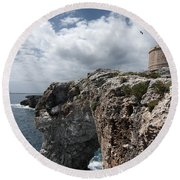 Stunning Tower Over The Cliffs Of Alcafar In Minorca Island - Tower And Sea Round Beach Towel