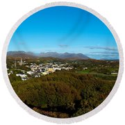 Town On A Hill With 12 Pin Mountain Round Beach Towel