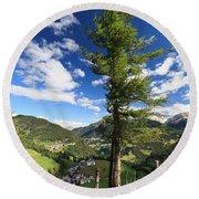 tree over Cordevole valley Round Beach Towel