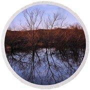 tree reflection on Wv pond Round Beach Towel