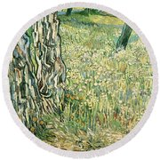 Tree Trunks In Grass Round Beach Towel