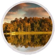 Trees Lining The Waters Edge Reflected Round Beach Towel