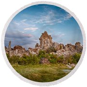 Tufa And Clouds Round Beach Towel