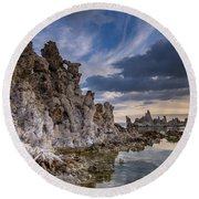 Tufas And Clouds Round Beach Towel