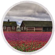 Tulips And Barns Round Beach Towel