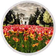Tulips And Building Round Beach Towel