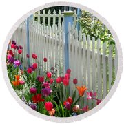 Tulips Garden Along White Picket Fence Round Beach Towel