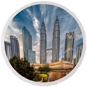 Twin Towers Kl Round Beach Towel by Adrian Evans