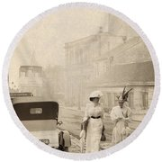 Two Edwardian Ladies Crossing A Cobbled Street Round Beach Towel
