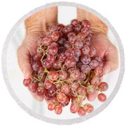 Two Handfuls Of Red Grapes Round Beach Towel