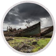 Two Large Boats Abandoned On The Shore Round Beach Towel