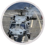 Two Mh-60s Sea Hawk Helicopters Take Round Beach Towel