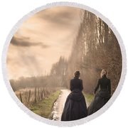 Two Victorian Ladies Walking On A Cobbled Path Round Beach Towel